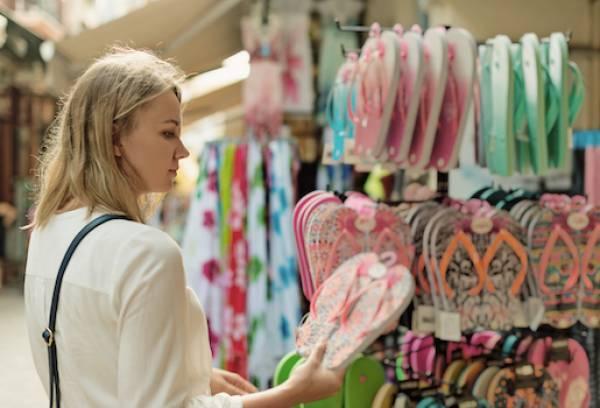 woman shopping for flip flops